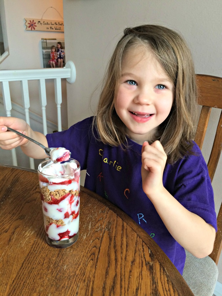 Charlie enjoying M&M Red Velvet Valentine parfaits
