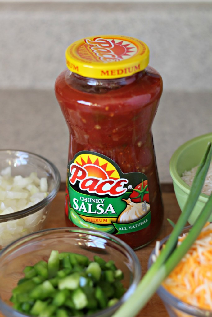 A little spicy and a whole lot of delicious try this Salsa Cheesy Rice and Beans Recipe. ad #KickUpTheFlavor