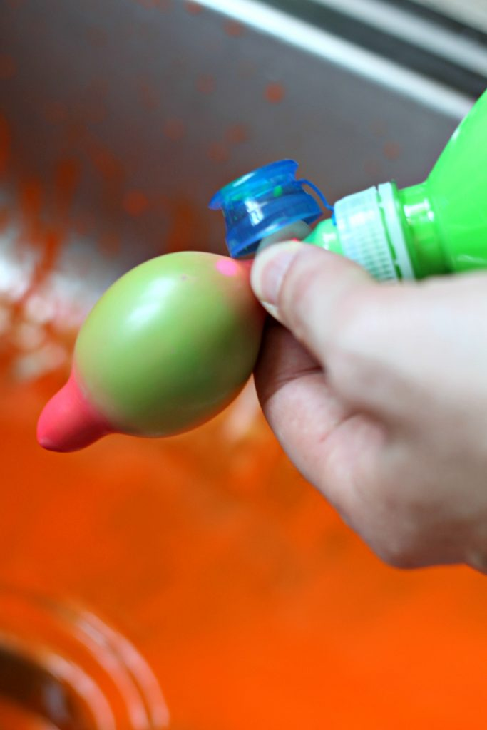 Bright colors, big messes and a whole lot of summer fun! A complete tutorial on how to create paint filled water balloon art projects. ad #BringTheTropicsHome