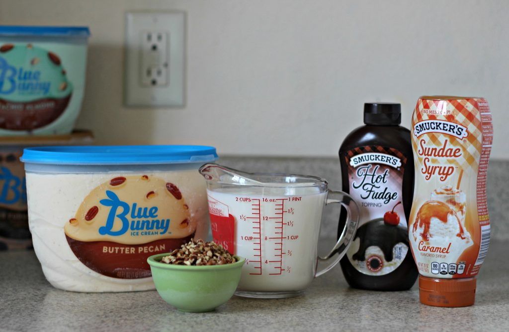 The perfect way to beat the heat this summer. Chocolate, caramel and pecans in milkshake form. Delicious! Ad #SoHoppinGood #TopYourSummer