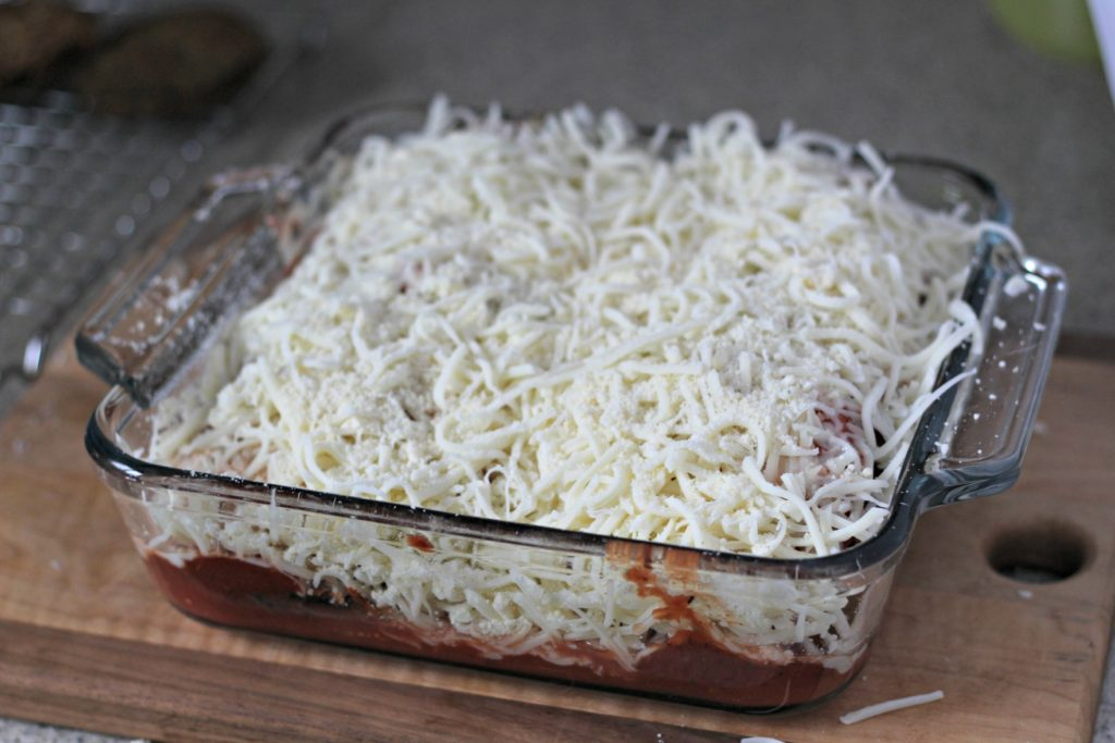 The perfect eggplant parmesan recipe including crispy eggplant, bold seasonings and gooey cheese. Your whole family will love this recipe!